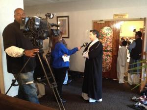 News 12 New Jersey speaking with AlFalah Center board member Omar Mohammedi. Photo courtesy of Arif Khan.